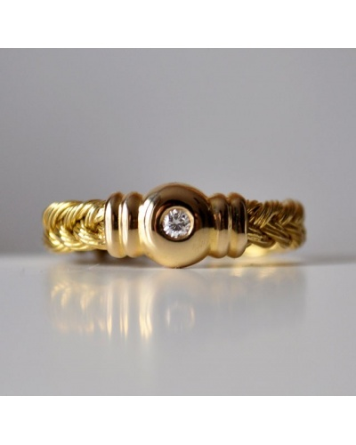 Anillo diamante oro amarillo 18 quilates trenzado